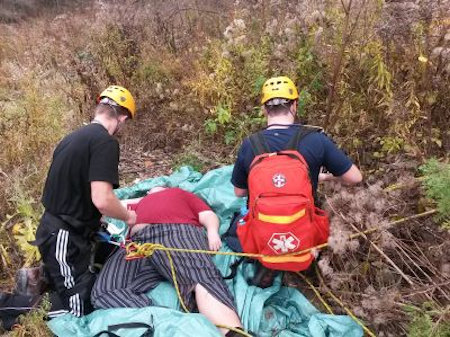 Rescuers tethered during rescue