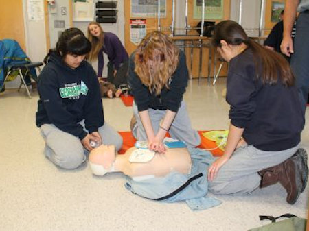 Students learning adult CPR & AED